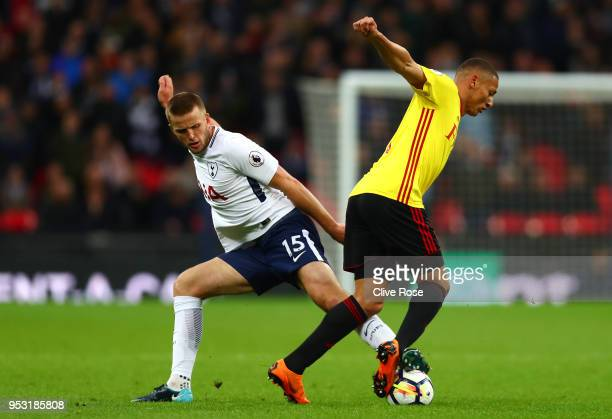 Eric Dier of Tottenham Hotspur tackles Richarlison de Andrade of Watford during the Premier League match between Tottenham Hotspur and Watford at...