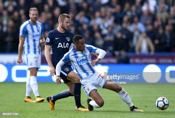 Eric Dier of Tottenham Hotspur tackles Tom Ince of Huddersfield Town during the Premier League match between Huddersfield Town and Tottenham Hotspur...