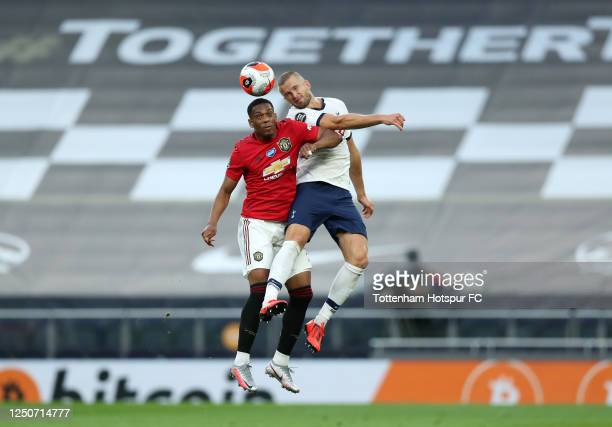 Eric Dier of Tottenham Hotspur wins a header over Anthony Martial of Manchester United during the Premier League match between Tottenham Hotspur and...