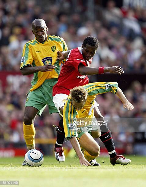 Eric Djemba-Djemba of Manchester United is challenged by Darren Huckerby and Damien Francis of Norwich City during the FA Barclays Premiership match...