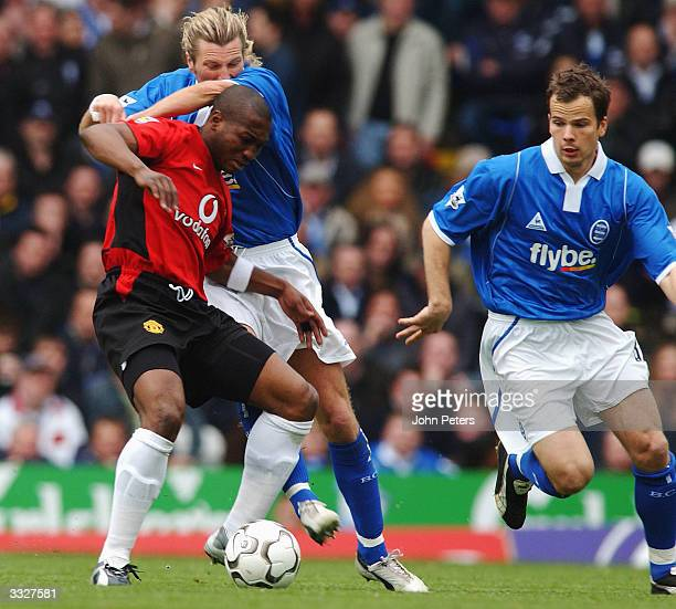 Eric DjembaDjemba of Manchester United tussles with Robbie Savage and Stephen Clemence of Birmingham City during the FA Barclaycard Premiership match...