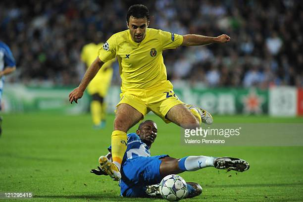 Eric Djemba-Djemba of OB Odense takes on Giuseppe Rossi of Villarreal CF during the UEFA Champions League play-off first leg match between Odense BK...