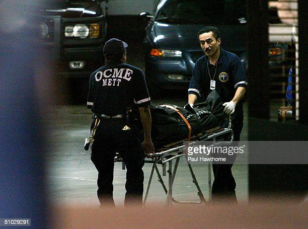 Eric Douglas youngest son of actor Kirk Douglas is taken out of an apartment building at 10 East 29th street after being found dead July 6 2004 in...