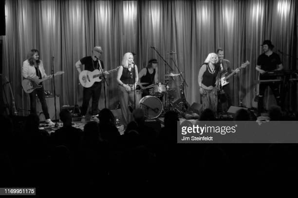 Eric Dover Dave Darling Cherie Currie Matt Oloffson Brie Darling Derek Frank Dave Schulz perform at the Grammy Museum in Los Angeles California on...