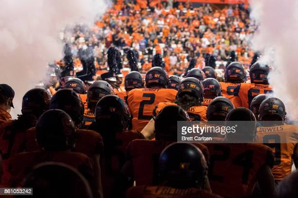 Eric Dungey of the Syracuse Orange and teammates exit the tunnel before the game against the Clemson Tigers at the Carrier Dome on October 13 2017 in...