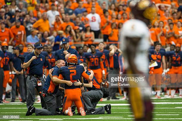 Eric Dungey of the Syracuse Orange is seen by trainers after suffering a first half injury which forced him to leave the game against the Central...