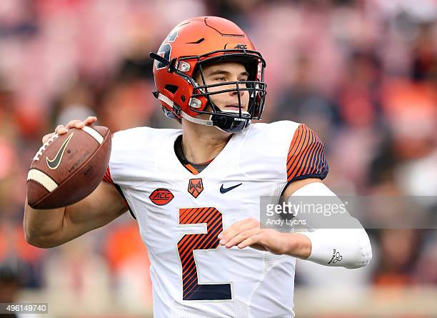 Eric Dungey of the Syracuse Orange throws a pass during the game against the Louisville Cardinals at Papa John's Cardinal Stadium on November 7 2015...