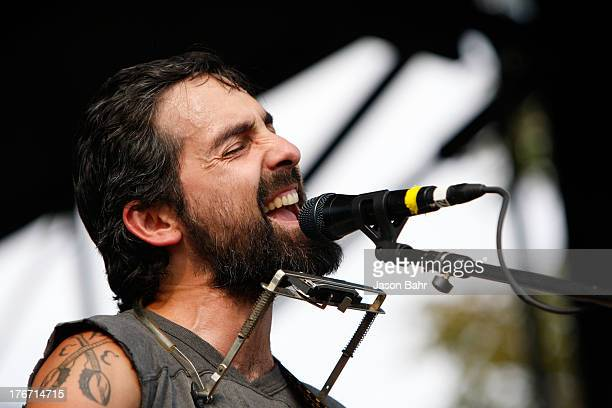 Eric Earley of music group Blitzen Trapper plays a set during Chipotle's Cultivate Denver at City Park on August 17 2013 in Denver Colorado