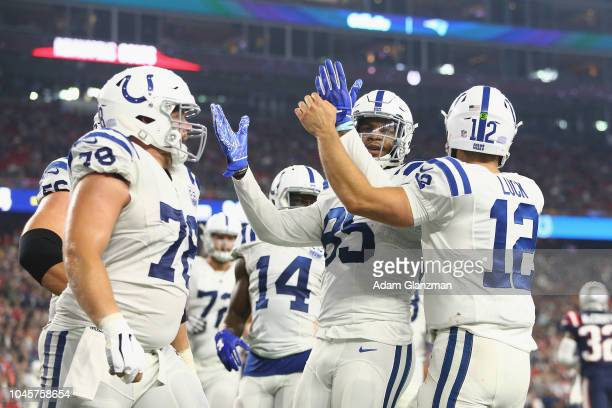 Eric Ebron and Andrew Luck of the Indianapolis Colts celebrate with teammates after scoring a touchdown during the third quarter against the New...