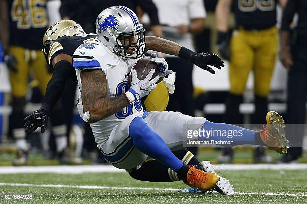 Eric Ebron of the Detroit Lions catches the ball as Vonn Bell of the New Orleans Saints defends during the first half of a game at the Mercedes-Benz...