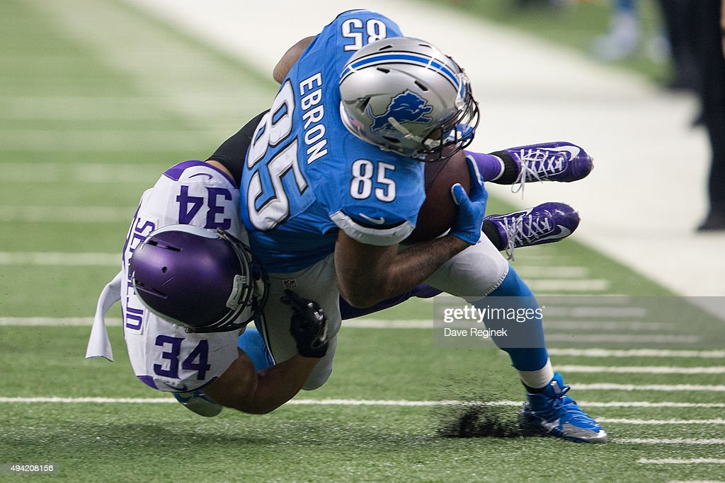 Eric Ebron #85 of the Detroit Lions is tacked by Andrew Sendejo #34 of the Minnesota Vikings in the first quarter during an NFL game at Ford Field on October 25, 2015 in Detroit, Michigan.
