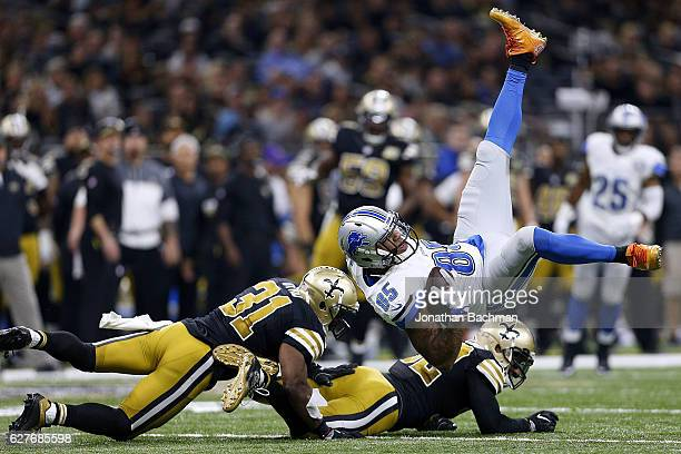 Eric Ebron of the Detroit Lions is tackled by Jairus Byrd of the New Orleans Saints and Kenny Vaccaro during the first half of a game at the...
