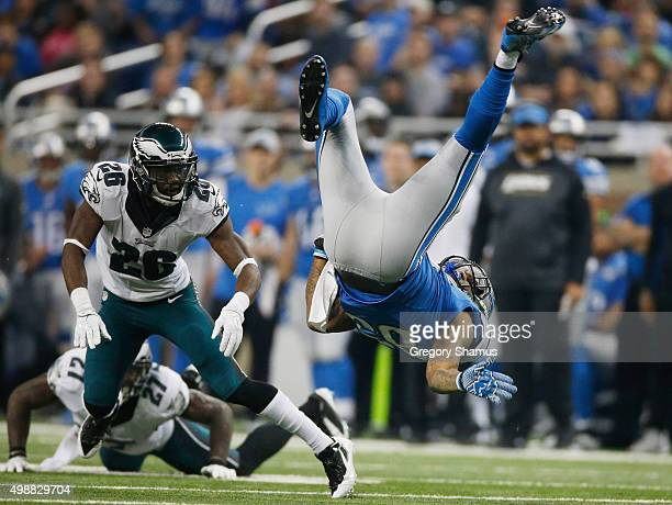 Eric Ebron of the Detroit Lions is tackled by Walter Thurmond of the Philadelphia Eagles after a second quarter reception at Ford Field on November...