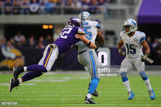 Eric Ebron of the Detroit Lions is wrapped up by Chad Greenway of the Minnesota Vikings after a reception during the first half of the game on...