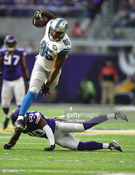 Eric Ebron of the Detroit Lions Mackensie Alexander of the Minnesota Vikings leaps over during the first half of the game on November 6, 2016 at US...