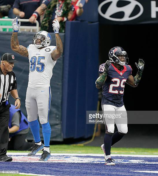 Eric Ebron of the Detroit Lions reacts after Andre Hal of the Houston Texans was called for pass interference in the second half at NRG Stadium on...