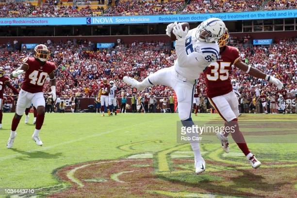 Eric Ebron of the Indianapolis Colts catches a first half touchdown pass in front of Montae Nicholson of the Washington Redskins at FedExField on...