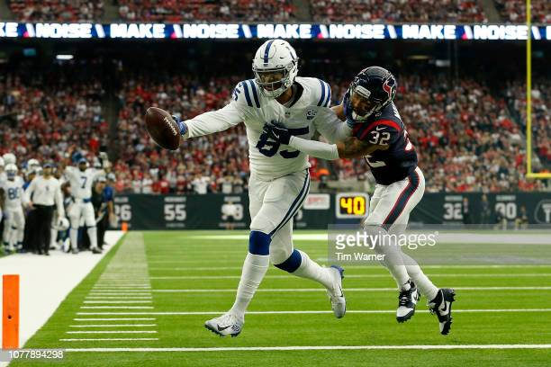 Eric Ebron of the Indianapolis Colts catches a pass for a touchdown defended by Tyrann Mathieu of the Houston Texans in the first quarter during the...