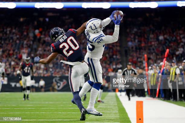 Eric Ebron of the Indianapolis Colts catches a pass in the second quarter defended by Justin Reid of the Houston Texans during the Wild Card Round at...