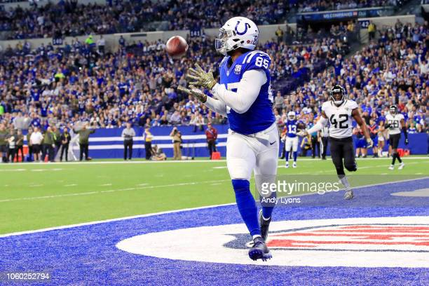 Eric Ebron of the Indianapolis Colts catches a touchdown pass in the game against the Jacksonville Jaguars in the second quarter at Lucas Oil Stadium...