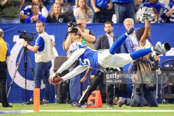 Eric Ebron of the Indianapolis Colts dives for a touchdown in the game against the Jacksonville Jaguars in the first quarter at Lucas Oil Stadium on...