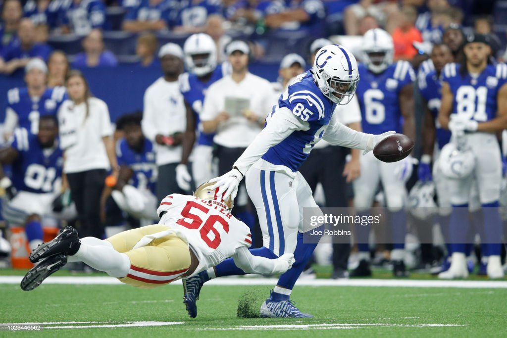 Eric Ebron #85 of the Indianapolis Colts runs after a reception against Reuben Foster #56 of the San Francisco 49ers in the second quarter of a preseason game at Lucas Oil Stadium on August 25, 2018 in Indianapolis, Indiana.