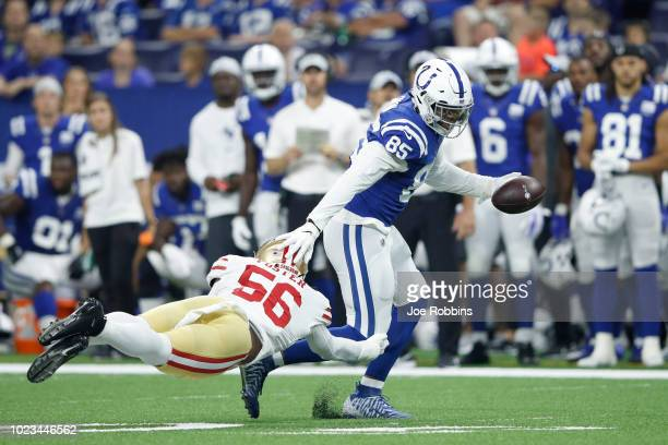Eric Ebron of the Indianapolis Colts runs after a reception against Reuben Foster of the San Francisco 49ers in the second quarter of a preseason...