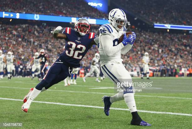Eric Ebron of the Indianapolis Colts scores a touchdown against Devin McCourty of the New England Patriots during the third quarter at Gillette...