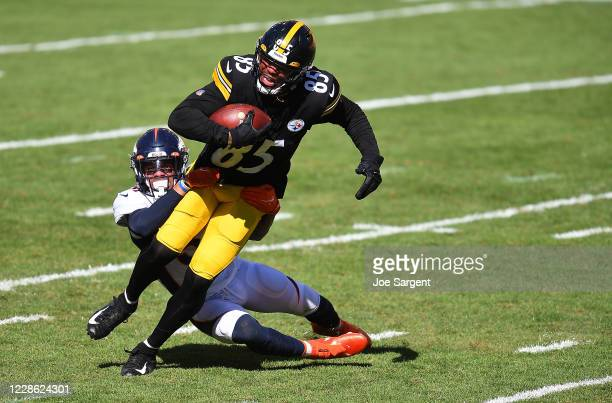 Eric Ebron of the Pittsburgh Steelers is dragged down by Justin Simmons of the Denver Broncos during the fourth quarter at Heinz Field on September...