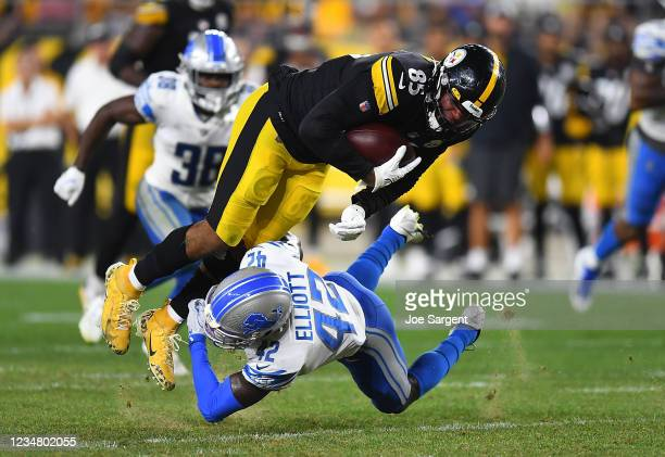 Eric Ebron of the Pittsburgh Steelers is tackled by Jalen Elliott of the Detroit Lions during the third quarter at Heinz Field on August 21, 2021 in...