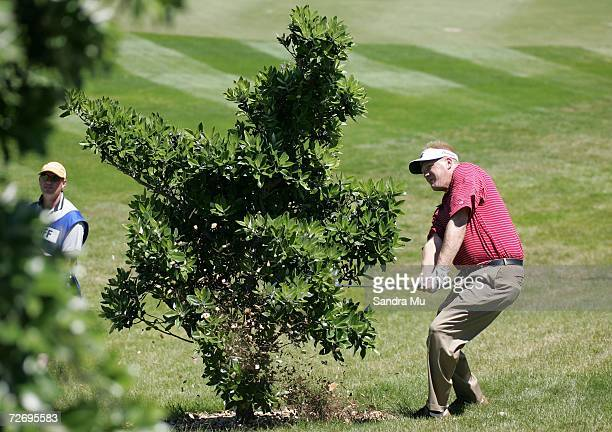 Eric Egloff of the U.S. Hits the ball from under a tree on the 16th hole during round three of the New Zealand Open at Gulf Harbour Country Club on...