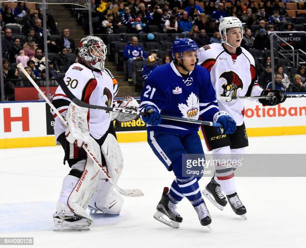 Eric Faille Toronto Marlies gets inbetween goalie Andrew Hammond and Chris Rumble of the Binghamton Senators during AHL game action on February 20...