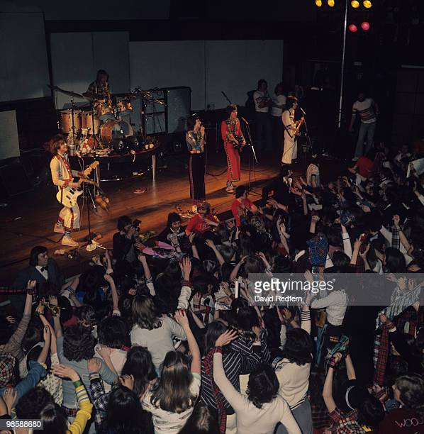 Eric Faulkner Derek Longmuir Les McKeown Alan Longmuir and Stuart Wood of the Bay City Rollers perform on stage in front of screaming fans in 1974