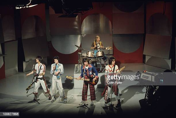 Eric Faulkner Les McKeown Alan Longmuir Derek Longmuir and Stuart Wood of the Bay City Rollers perform on a BBC television show in 1975