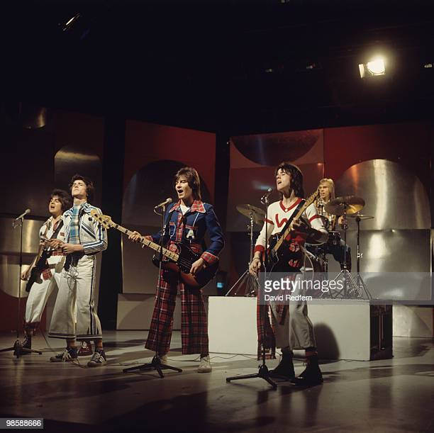 Eric Faulkner Les McKeown Alan Longmuir Stuart Wood and Derek Longmuir of the Bay City Rollers perform on a BBC television show in 1975