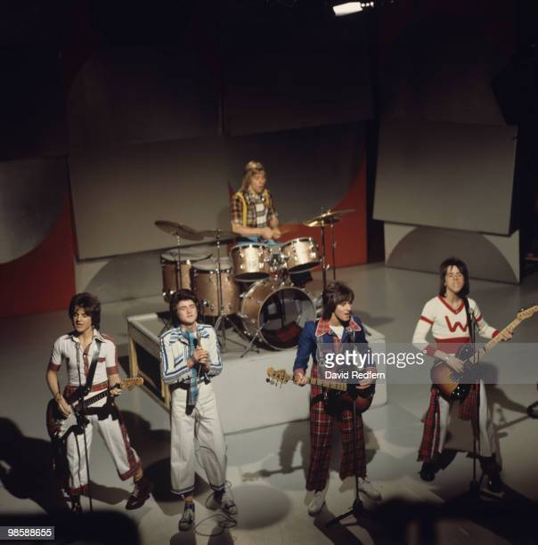 Eric Faulkner Les McKeown Derek Longmuir Alan Longmuir and Stuart Wood of the Bay City Rollers perform on a BBC television show in 1975