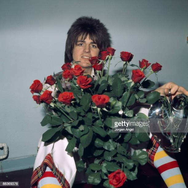 Eric Faulkner of pop group the Bay City Rollers poses with flowers sent to him for his birthday by fans on October 21st 1975 in Nykobing Falster...