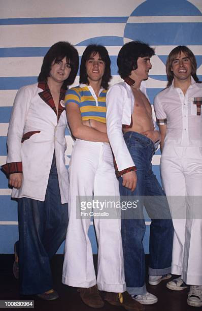 Eric Faulkner Stuart Wood Les McKeown and Derek Longmuir of the Bay City Rollers backstage in June 1977
