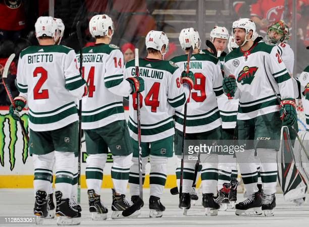 Eric Fehr of the Minnesota Wild and the rest of his teammates celebrate the 42 win over the New Jersey Devils at Prudential Center on February 09...