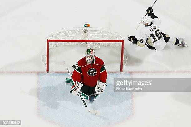 Eric Fehr of the Pittsburgh Penguins celebrates after scoring a goal as Devan Dubnyk of the Minnesota Wild reacts during the game on December 26 2015...