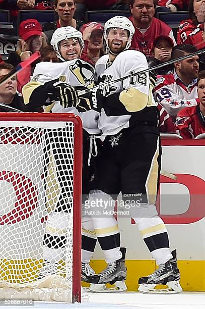 Eric Fehr of the Pittsburgh Penguins celebrates with his teammate after scoring a goal in the third period against the Washington Capitals in Game...