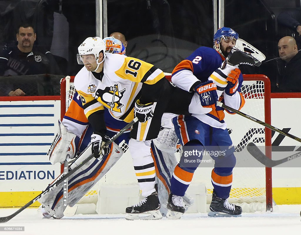 Eric Fehr #16 of the Pittsburgh Penguins moves through the crease and gets tangled up with Nick Leddy #2 of the New York Islanders during the second period at the Barclays Center on November 30, 2016 in the Brooklyn borough of New York City.
