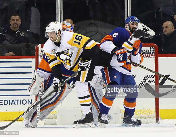 Eric Fehr of the Pittsburgh Penguins moves through the crease and gets tangled up with Nick Leddy of the New York Islanders during the second period...