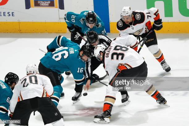Eric Fehr of the San Jose Sharks and Derek Grant of the Anaheim Ducks faceoff in Game Three of the Western Conference First Round during the 2018 NHL...