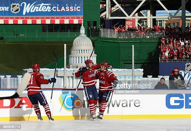 Eric Fehr of the Washington Capitals celebrates his goal in the first period with teammates against the Chicago Blackhawks during the 2015...