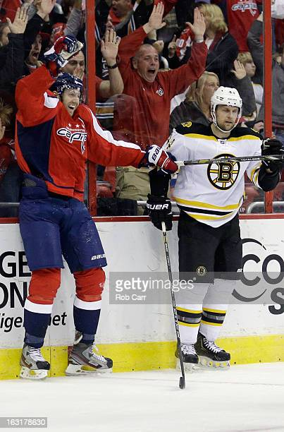 Eric Fehr of the Washington Capitals celebrates in front of Dennis Seidenberg of the Boston Bruins after scoring the game winning goal in overtime to...