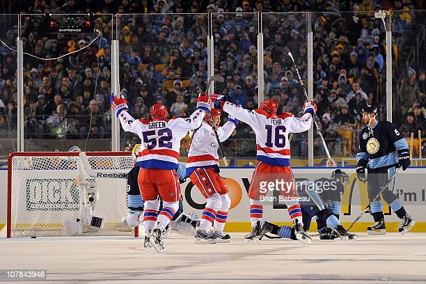 Eric Fehr of the Washington Capitals celebrates with his teammates after scoring a goal against the Pittsburgh Penguins in the 2nd period during the...