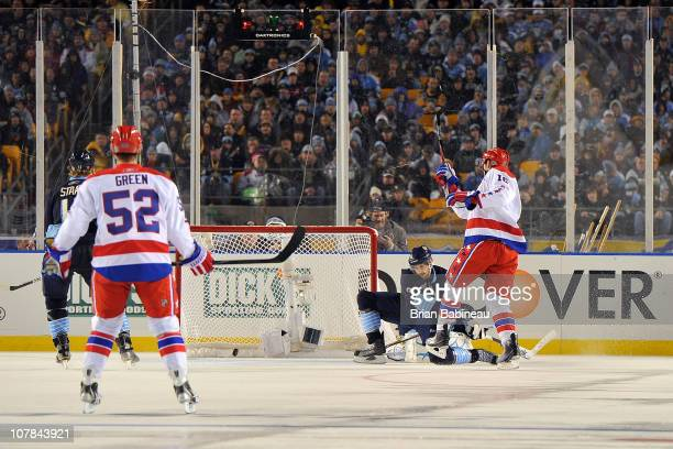 Eric Fehr of the Washington Capitals scores a goal against the Pittsburgh Penguins in the 2nd period during the 2011 NHL Bridgestone Winter Classic...