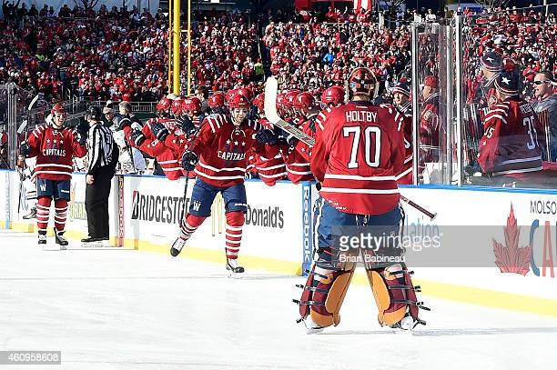 Eric Fehr of the Washington Capitals skates by the Capital's bench to celebrate his goal first period goal against the Chicago Blackhawks during the...