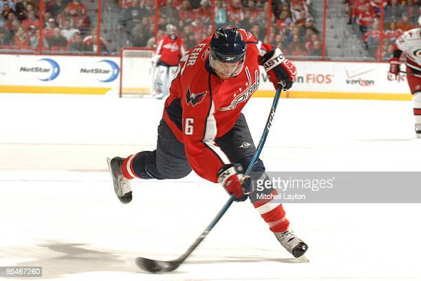 Eric Fehr of the Washington Capitals takes a shot during a NHL hockey game against the Carolina Hurricanes on December11 2009 at the Verizon Center...